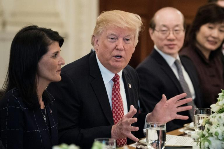 US Ambassador to the UN Nikki Haley (L) and China's Ambassador to the UN Liu Jieyi (2R)  listens while US President Donald Trump (2L) speaks before a working lunch with UN Security Council member nations in  the White House April 24, 2017