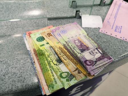 Saudi currency, riyal, is seen at a local currency exchange in Manama