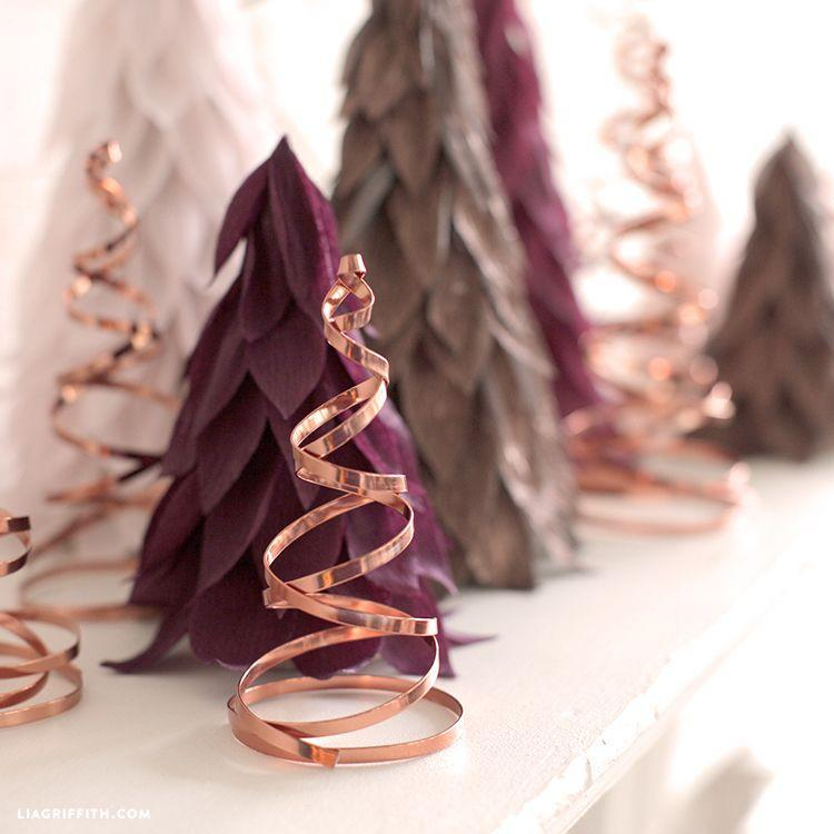 "<p>Copper adds a bit of glam to your holiday display. These trees are so pretty, you'll want to leave them up year-round.</p><p>Get the tutorial at <a href=""https://liagriffith.com/copper-wire-spiral-trees/"" rel=""nofollow noopener"" target=""_blank"" data-ylk=""slk:Lia Griffith"" class=""link rapid-noclick-resp"">Lia Griffith</a>.</p>"