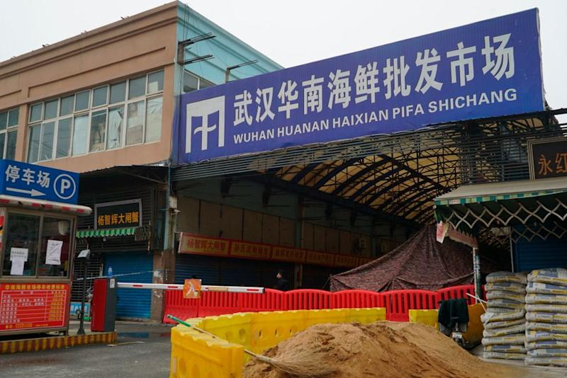 The Wuhan Huanan Wholesale Seafood Market, where a number of people related to the market fell ill with a virus, sits closed in China's central city of Wuhan on Tuesday.