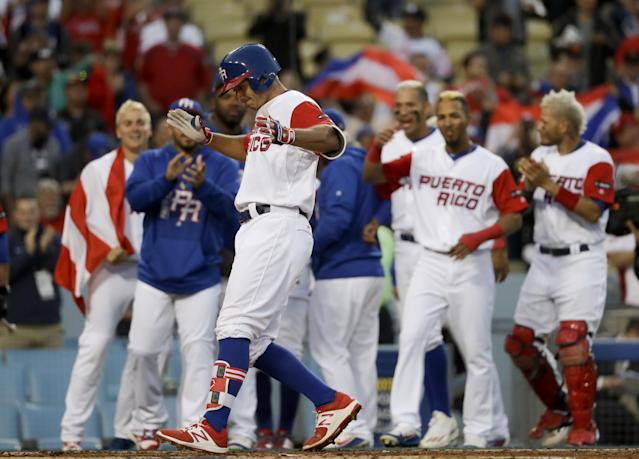 <p>Puerto Rico's T.J. Rivera celebrates after his home run against the Netherlands during the second inning of a semifinal in the World Baseball Classic in Los Angeles, Monday, March 20, 2017. (AP Photo/Chris Carlson) </p>