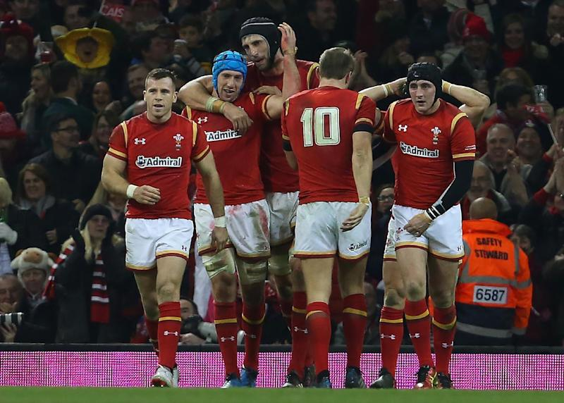 Wales' flanker Justin Tipuric (2nd L) celebrates with teammates after scoring his second half try during the rugby union test match between Wales and South Africa at the Principality stadium in Cardiff, south Wales, on November 26, 2016.Wales won the game 27-13. (AFP Photo/Geoff CADDICK)