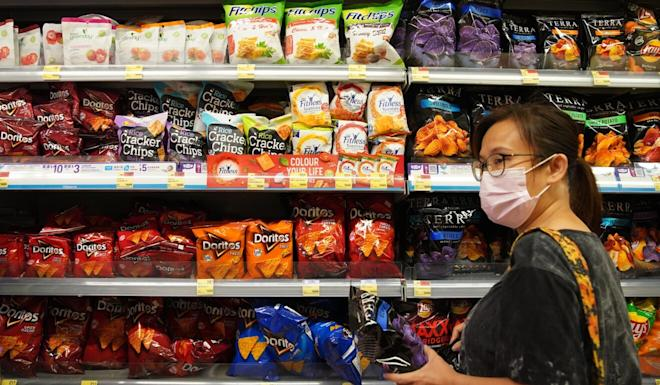A woman shops for crisps at a ParknShop in Tseung Kwun O in August. Photo: Winson Wong