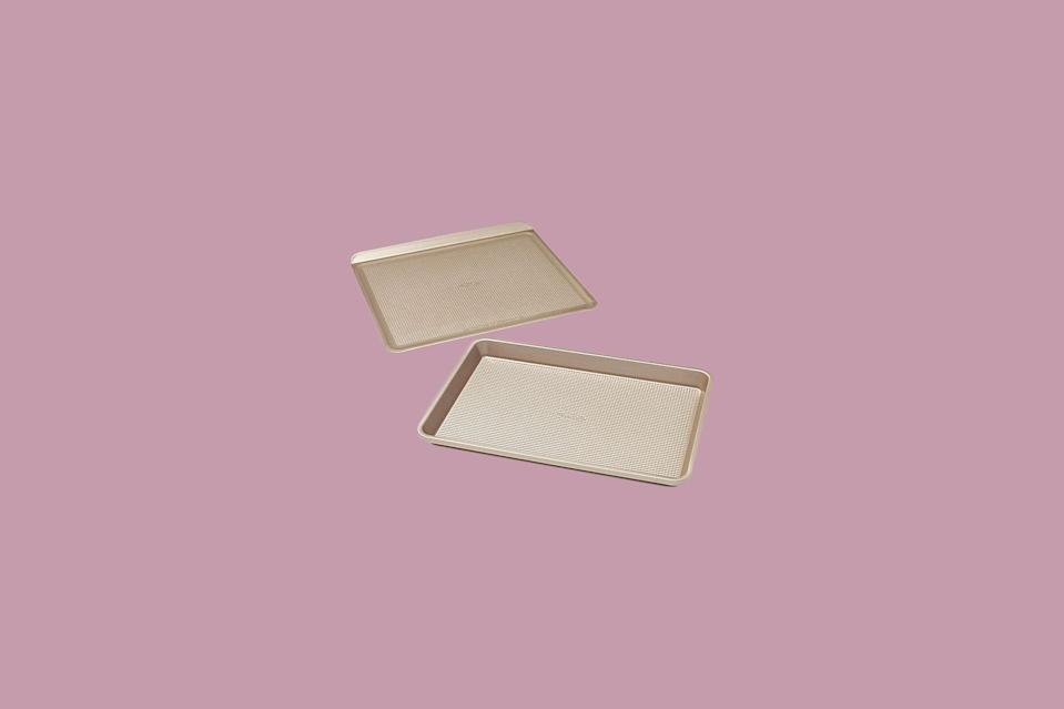 """<p>A rimmed baking sheet and a rimless cookie sheet make up this set, meaning you can deftly toggle between chewy <a href=""""https://www.marthastewart.com/333938/old-fashioned-sugar-cookies"""" rel=""""nofollow noopener"""" target=""""_blank"""" data-ylk=""""slk:lemon sugar cookies"""" class=""""link rapid-noclick-resp"""">lemon sugar cookies</a> and crispy roasted <a href=""""https://www.marthastewart.com/1543922/roasted-brussels-sprouts-with-honey-chipotle-glaze"""" rel=""""nofollow noopener"""" target=""""_blank"""" data-ylk=""""slk:Brussels sprouts"""" class=""""link rapid-noclick-resp"""">Brussels sprouts</a>. The micro-textured surface increases airflow to the bottom of the food and stabilizes the sheet to make it more resistant to warping. Many nonstick pans come in darker colors due to the nonstick coating, which isn't ideal for all recipes. The lighter color of this set from OXO makes this a good all-purpose choice.</p> <p><strong><em>Shop Now: </em></strong><em>OXO Good Grips Sweet & Savory 2-Piece Bakeware Set, $39.99, <a href=""""http://www.anrdoezrs.net/links/7799179/type/dlg/sid/MSLOurShoppableGuidetoSheetPansandCookieSheetsvspence2FooGal7847984202007I/https://www.bedbathandbeyond.com/store/product/oxo-good-grips-reg-sweet-amp-savory-2-piece-bakeware-set/5382707?keyword=baking-sheet"""" rel=""""nofollow noopener"""" target=""""_blank"""" data-ylk=""""slk:bedbathandbeyond.com"""" class=""""link rapid-noclick-resp"""">bedbathandbeyond.com</a>.</em></p>"""