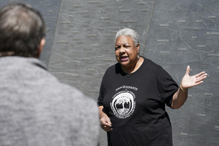 """Cauline Yates, descendant of one of Thomas Jefferson's slave mistresses, talks about the Memorial to Enslaved Laborers at the University of Virginia in Charlottesville, Va., Thursday, May 6, 2021. In Virginia, a new law mandates the state's five public colleges provide """"tangible benefits"""" for slave descendants. (AP Photo/Steve Helber)"""
