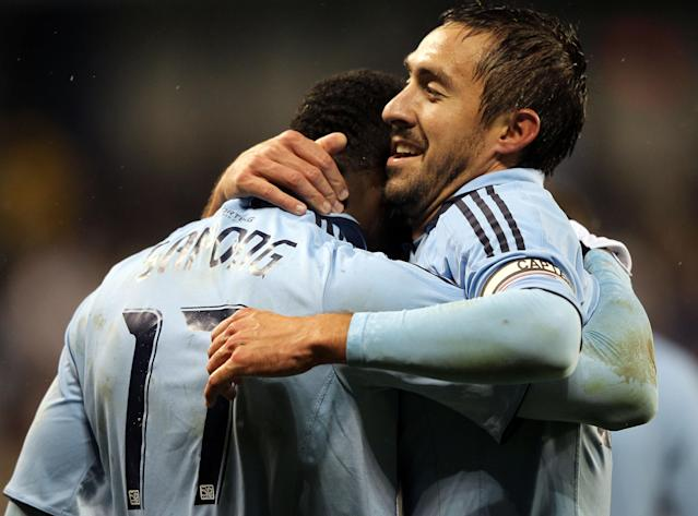 KANSAS CITY, KS - NOVEMBER 02: C.J. Sapong #17 of Sporting Kansas City is congratulated by Davy Arnaud #22 after scoring during the MLS playoff game against the Colorado Rapids on November 2, 2011 at LiveStrong Sporting Park in Kansas City, Kansas. (Photo by Jamie Squire/Getty Images)