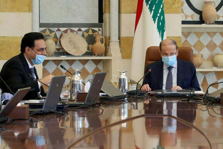 Lebanese President Michel Aoun (right) and Prime Minister Hassan Diab wear protective masks during a cabinet meeting at the Baabda presidential palace (AFP Photo/STRINGER)