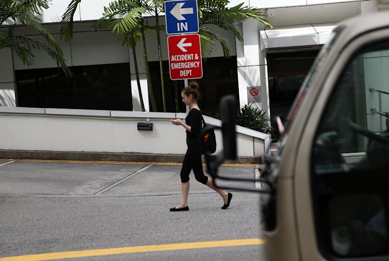 People walk past the Mount Elizabeth Hospital on Thursday Dec. 27, 2012 in Singapore. A young woman who was gang-raped and assaulted on a moving bus in the Indian capital was flown Thursday to the Singapore hospital for treatment of severe internal injuries that could last several weeks, officials said. (AP Photo/Wong Maye-E)