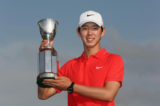 AVONDALE, LA - APRIL 27: Seung-Yul Noh poses for a photo with the Zurich trophy after winning the Final Round of the Zurich Classic of New Orleans at TPC Louisiana on April 26, 2014 in Avondale, Louisiana. (Photo by Chris Graythen/Getty Images)