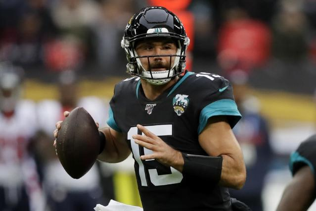 Jacksonville Jaguars quarterback Gardner Minshew (15) works in the pocket against the Houston Texans during the first half of an NFL football game at Wembley Stadium, Sunday, Nov. 3, 2019, in London. (AP Photo/Kirsty Wigglesworth)
