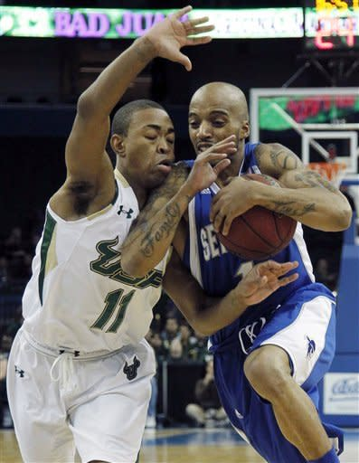 Seton Hall guard Jordan Theodore, right, is fouled by South Florida guard Anthony Collins during the first half of an NCAA college basketball game, Friday Jan. 13, 2012, in Tampa, Fla. (AP Photo/Chris O'Meara)