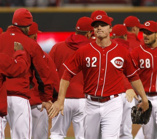 Cincinnati Reds' Jay Bruce (32) is congratulated by teammates after they defeated the Houston Astros 6-0 during a baseball game on Saturday, April 28, 2012, in Cincinnati. The Reds won 6-0. (AP Photo/David Kohl)