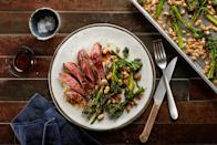 """Balsamic-marinated steak cooks over the broccolini and white beans in this <a href=""""https://www.epicurious.com/recipes-menus/easy-sheet-pan-dinners-recipes-chicken-salmon-shrimp-steak-fast-weeknight-meals-gallery?mbid=synd_yahoo_rss"""" rel=""""nofollow noopener"""" target=""""_blank"""" data-ylk=""""slk:sheet-pan dinner"""" class=""""link rapid-noclick-resp"""">sheet-pan dinner</a>, flavoring them with its tasty juices. <a href=""""https://www.epicurious.com/recipes/food/views/sheet-pan-skirt-steak-with-balsamic-vinaigrette-broccolini-and-white-beans-56390002?mbid=synd_yahoo_rss"""" rel=""""nofollow noopener"""" target=""""_blank"""" data-ylk=""""slk:See recipe."""" class=""""link rapid-noclick-resp"""">See recipe.</a>"""