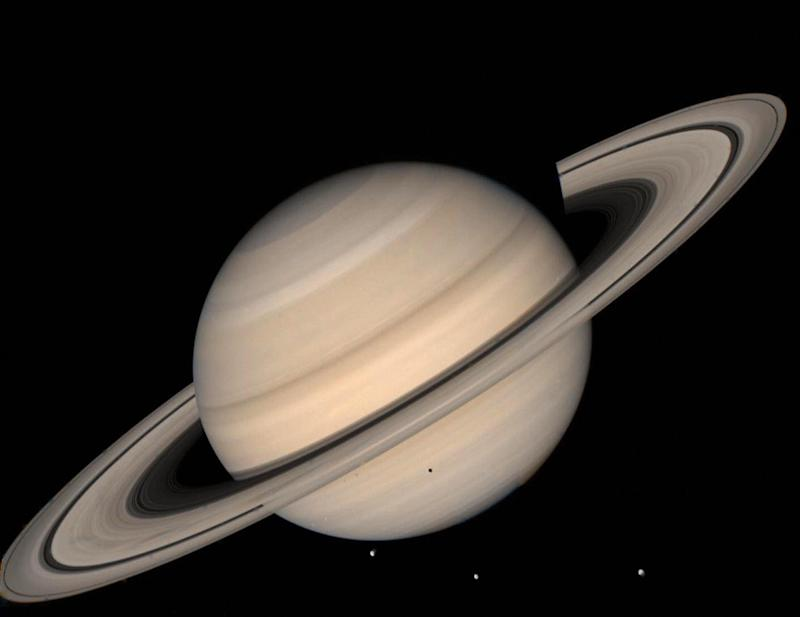 Cassini's voyage to Saturn has returned data showing some of its moons could support life - Credit: AFP