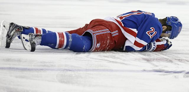 In this May 22, 2014 file photo, New York Rangers center Derek Stepan (21) lies on the ice after taking a hit from Montreal Canadiens forward Brandon Prust during the first period of Game 3 of the NHL hockey Stanley Cup playoffs Eastern Conference finals in New York. Stepan has a broken jaw and is undergoing surgery. Rangers coach Alain Vigneault made the surprising announcement Friday, May 23, 2014, on the first of two off days in the series New York leads 2-1. Prust wasn't penalized in the first period of Montreal's 3-2 overtime win Thursday night, but he faces an NHL hearing Friday and a possible suspension. (AP Photo/Kathy Willens)