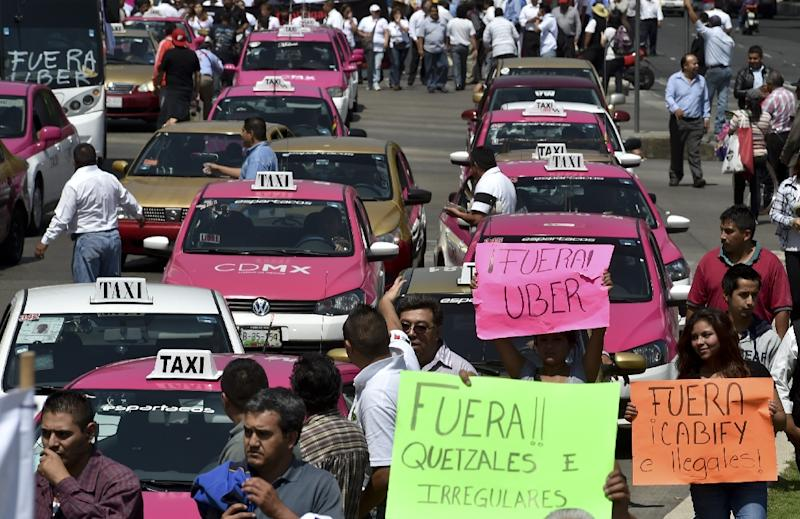 Taxi drivers take part in a protest against the private taxi company Uber for alleged unfair competition, in Mexico City on May 25, 2015