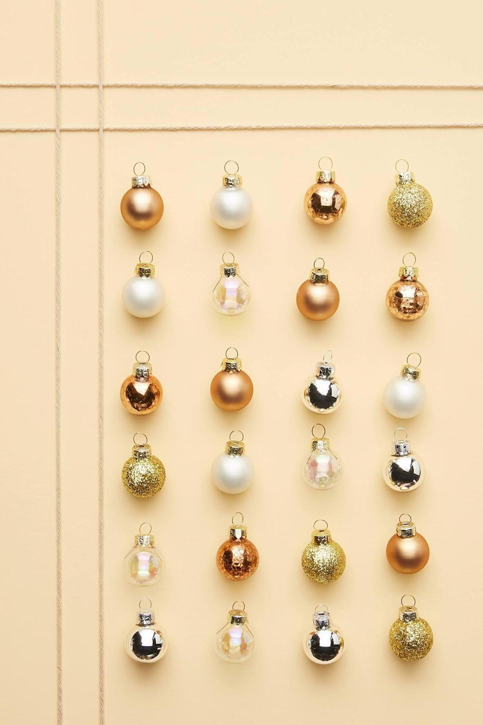 """<p>Add shine and shimmer to your Christmas tree with the <a href=""""https://www.popsugar.com/buy/Copper-Mini-Ornaments-Set-24-490482?p_name=Copper%20Mini%20Ornaments%2C%20Set%20of%2024&retailer=anthropologie.com&pid=490482&price=12&evar1=casa%3Aus&evar9=46615300&evar98=https%3A%2F%2Fwww.popsugar.com%2Fhome%2Fphoto-gallery%2F46615300%2Fimage%2F46615352%2FCopper-Mini-Ornaments-Set-24&list1=shopping%2Canthropologie%2Choliday%2Cchristmas%2Cchristmas%20decorations%2Choliday%20decor%2Chome%20shopping&prop13=mobile&pdata=1"""" rel=""""nofollow noopener"""" class=""""link rapid-noclick-resp"""" target=""""_blank"""" data-ylk=""""slk:Copper Mini Ornaments, Set of 24"""">Copper Mini Ornaments, Set of 24</a> ($12).</p>"""