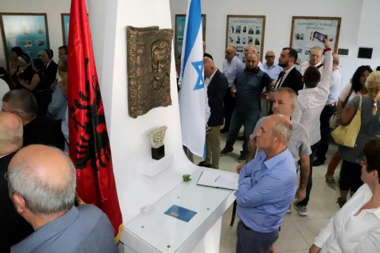 """Visitors attend the opening ceremony of the renovated Solomon Jewish hisory museum in the Albanian city of Berat, on September 29, 2019.Albania's sole Jewish history museum reopened in southern Berat on September 29, thanks to a businessman who rescued it from the brink of closure. The small """"Solomon Museum"""", which tells the story of how Muslim and Christian Albanians sheltered hundreds of Jews during the Holocaust, was the passion project of a local professor, Simon Vrusho (AFP Photo/STRINGER)"""