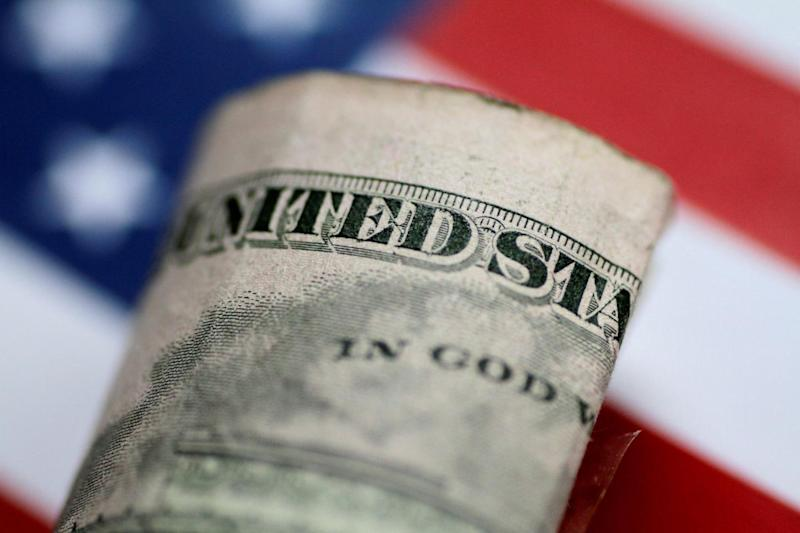 FILE PHOTO: A U.S. five dollar note is seen in this illustration photo June 1, 2017. REUTERS/Thomas White/Illustration/File Photo
