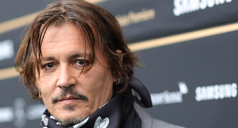 "<a href=""https://uk.news.yahoo.com/tagged/johnny-depp/"" data-ylk=""slk:Johnny Depp"" class=""link rapid-noclick-resp"">Johnny Depp</a> lost his <a href=""https://uk.news.yahoo.com/news/johnny-depp-loses-wife-beater-libel-case-the-sun-101443827.html"" data-ylk=""slk:&quot;wife beater&quot; libel case;outcm:mb_qualified_link;_E:mb_qualified_link;ct:story;"" class=""link rapid-noclick-resp yahoo-link"">""wife beater"" libel case</a> against The Sun in November. He sued the paper over the claims he had assaulted ex-wife Amber Heard but the presiding judge found the content of the article to be ""substantially true"". Depp was subsequently dropped from film <em>Fantastic Beasts 3</em>. (Photo by Andreas Rentz/Getty Images for ZFF)"