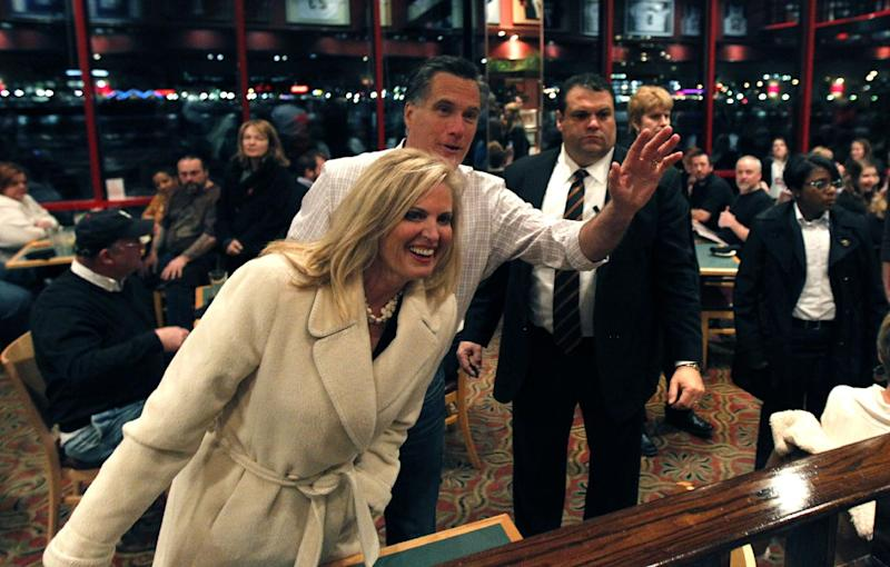 Republican presidential candidate, former Massachusetts Gov. Mitt Romney and his wife Ann wish a patron happy birthday at the Montgomery Inn in Cincinnati, Saturday, March 3, 2012. Mitt Romney stepped out to a solid lead over his Republican presidential rivals Saturday night in Washington state caucuses, a quiet prelude to 10 Super Tuesday contests next week in all regions of the country. (AP Photo/Gerald Herbert)