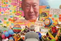People pay their respects to Lee Kuan Yew at a memorial outside the Singapore General Hospital on March 23, 2015