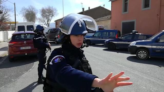 <p>Police respond to an incident in Trèbes, southern France, Friday March 23, 2018. French counterterrorism prosecutors are taking charge of the investigation into the shooting of a police officer in southern France that has led to an apparent hostage-taking at a supermarket. (Photo: La Depeche Du Midi via AP) </p>