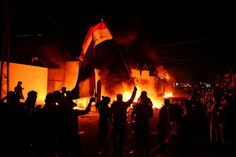 Iraqi demonstrators, angry at neighbouring Iran's support for the entrenched Baghdad political elite, torch its consulate in the Shiite shrine city of Najaf (AFP Photo/Haidar HAMDANI)