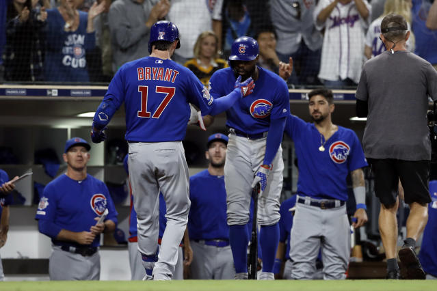 Chicago Cubs' Kris Bryant (17) is greeted by teammates after hitting a two-run home run during the eighth inning of the team's baseball game against the San Diego Padres on Tuesday, Sept. 10, 2019, in San Diego. (AP Photo/Gregory Bull)