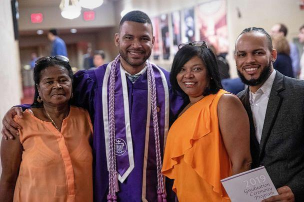 PHOTO: Frank Baez poses with his family after graduating from NYU Rory Meyers College of Nursing, May 20, 2019. (Kate Lord/New York University)