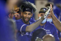 Toronto Blue Jays' Lourdes Gurriel Jr. celebrates after scoring against the Philadelphia Phillies during the second inning of a baseball game Saturday, May 15, 2021, in Dunedin, Fla. (AP Photo/Mike Carlson)
