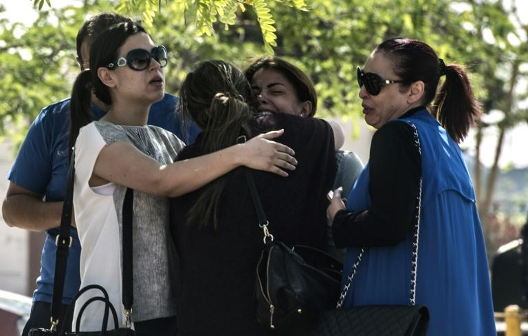 Anxious relatives of passengers who were flying aboard the EgyptAir plane that crashed into the Mediterranean, console each other outside Cairo airport, on May 19, 2016