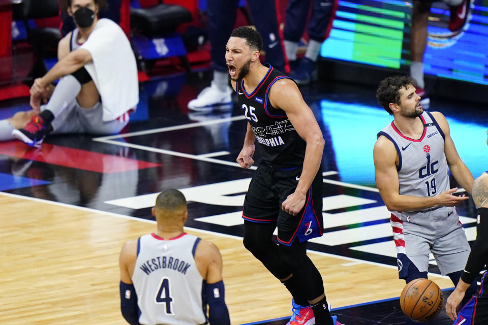 Philadelphia 76ers' Ben Simmons reacts after a dunk during the second half of Game 1 of a first-round NBA basketball playoff series against the Washington Wizards, Sunday, May 23, 2021, in Philadelphia. (AP Photo/Matt Slocum)