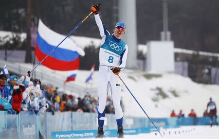 Cross-Country Skiing - Pyeongchang 2018 Winter Olympics - Men's 50km Mass Start Classic - Alpensia Cross-Country Skiing Centre - Pyeongchang, South Korea - February 24, 2018 - Iivo Niskanen of Finland celebrates winning the race. REUTERS/Kai Pfaffenbach