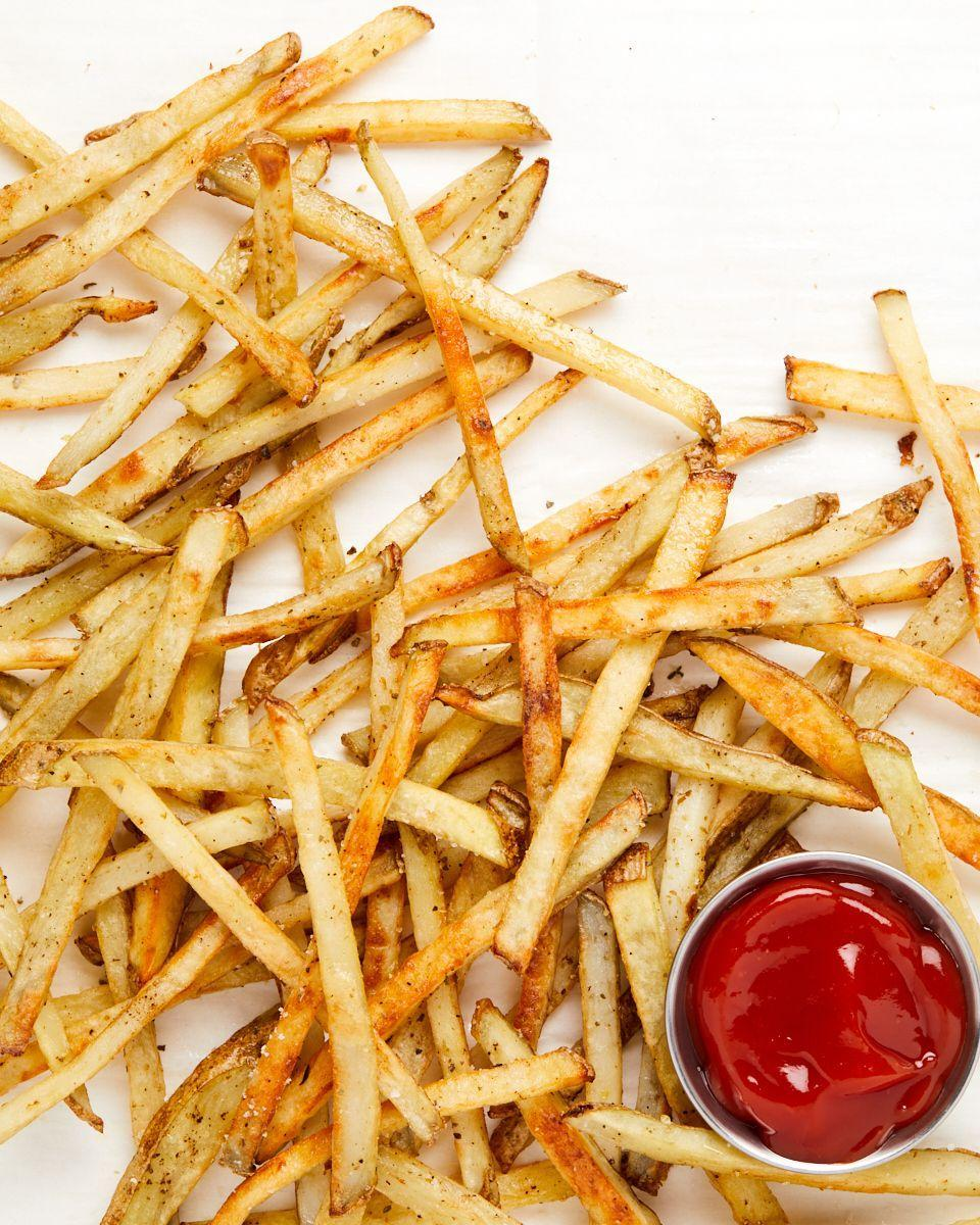 """<p>These beautiful babies are ready in 30 minutes and the easy clean-up cannot be beat.</p><p>Get the recipe from <a href=""""https://www.delish.com/cooking/recipe-ideas/a35769848/oven-baked-fries-recipe/"""" rel=""""nofollow noopener"""" target=""""_blank"""" data-ylk=""""slk:Delish"""" class=""""link rapid-noclick-resp"""">Delish</a>.</p>"""