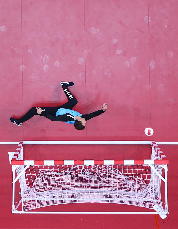 <p>TOKYO, JAPAN - JULY 26: Niklas Landin of Team Denmark dives for the ball during the Men's Preliminary Round Group B match between Egypt and Denmark on day three of the Tokyo 2020 Olympic Games at Yoyogi National Stadium on July 26, 2021 in Tokyo, Japan. (Photo by Dean Mouhtaropoulos/Getty Images)</p>