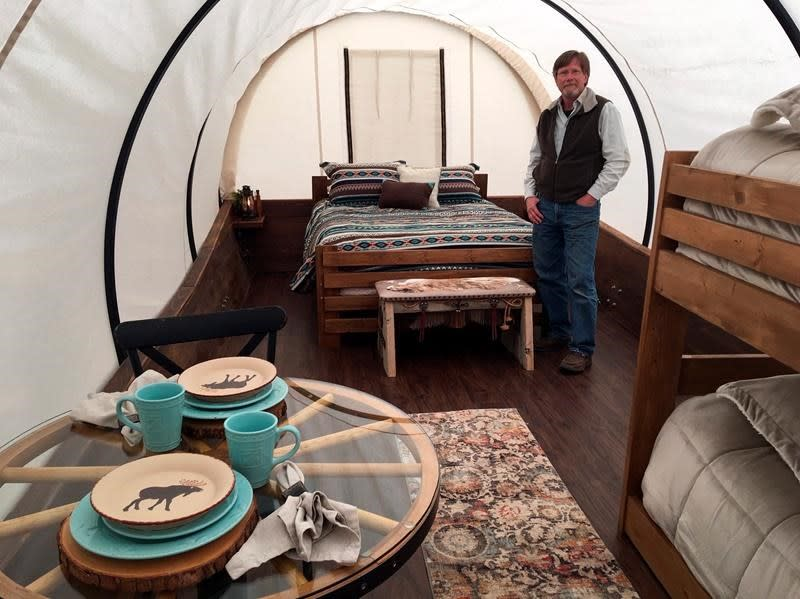 Kansas couple designs covered wagons for 'glamping'