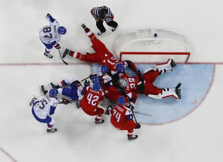 Ice Hockey – Pyeongchang 2018 Winter Olympics – Men Preliminary Round Match – Czech Republic v South Korea - Gangneung Hockey Centre, Gangneung, South Korea – February 15, 2018 - Goalie Pavel Francouz of the Czech Republic (33) sprawls on the ice during third period action. REUTERS/Brian Snyder