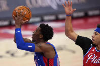 Detroit Pistons guard Delon Wright takes a shot as Philadelphia 76ers guard Seth Curry defends during the first half of an NBA basketball game, Saturday, Jan. 23, 2021, in Detroit. (AP Photo/Carlos Osorio)