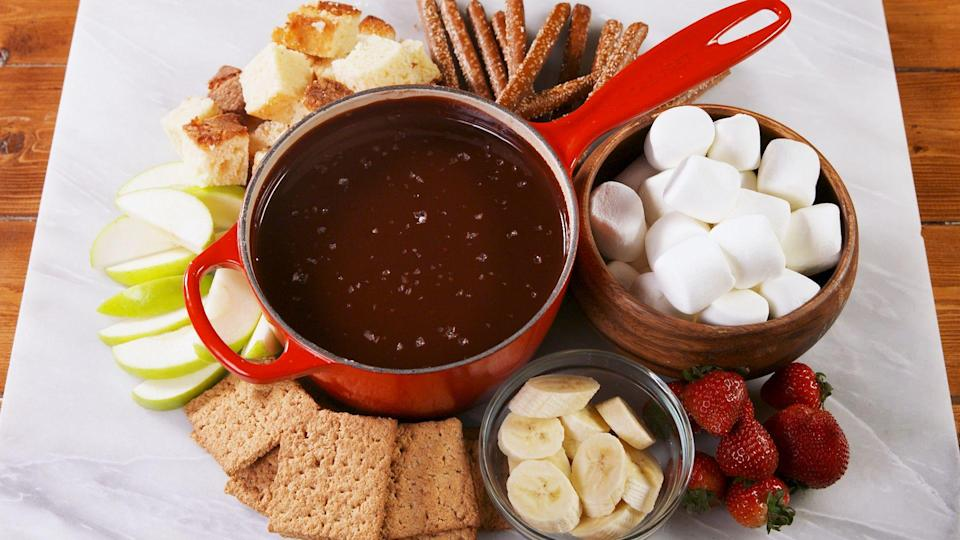 """<p>Is there anything better in life than melted chocolate and cheese?</p><p>Need more New Year's eats? Try our <a href=""""https://www.delish.com/holiday-recipes/thanksgiving/g3137/last-minute-thanksgiving-appetizers/"""" rel=""""nofollow noopener"""" target=""""_blank"""" data-ylk=""""slk:75 amazing party appetizers"""" class=""""link rapid-noclick-resp"""">75 amazing party appetizers</a>.</p>"""