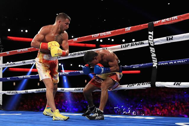 "Vasyl Lomachenko (L) puts the finishing touches on <a class=""link rapid-noclick-resp"" href=""/olympics/rio-2016/a/1152098/"" data-ylk=""slk:Miguel Marriaga"">Miguel Marriaga</a> Saturday in their WBO super featherweight title bout at the Microsoft Theater in Los Angeles. (Getty Images)"