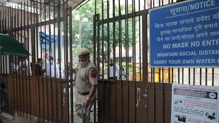 A police officer at the Rohini court after a shootout in New Delhi, India 24 September 2021.