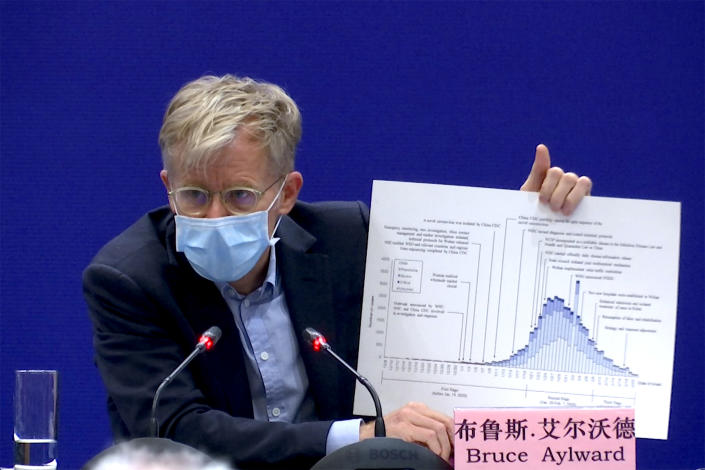 Dr. Bruce Aylward, an assistant director-general of the World Health Organization speaks with a chart during a press conference about China's response to the new COVID-19 coronavirus, in Beijing on Monday, Feb. 24, 2020.  (Sam McNeil/AP)