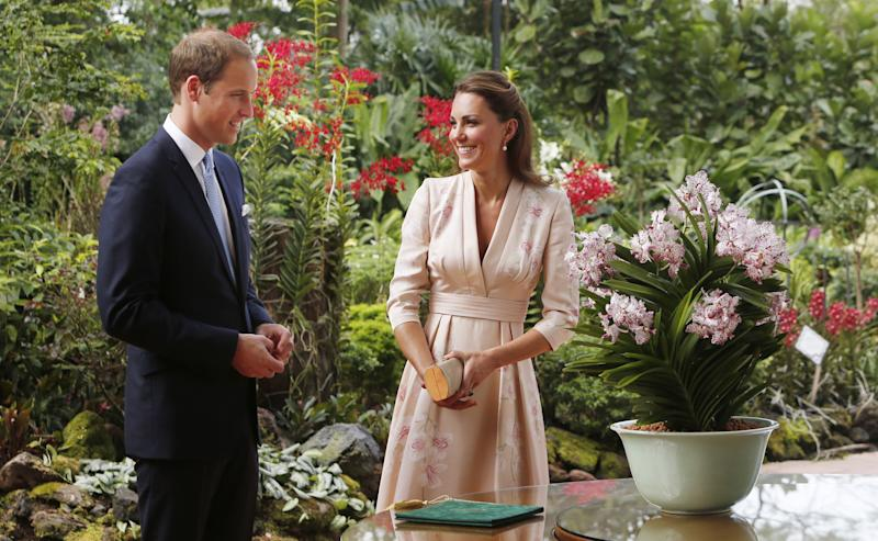The Duke and Duchess of Cambridge look at an orchid named in their honour during their first engagement in Singapore, as part of a nine-day tour of the Far East and South Pacific in honour of the Queen's Diamond Jubilee. (Photo by Danny Lawson/PA Images via Getty Images)
