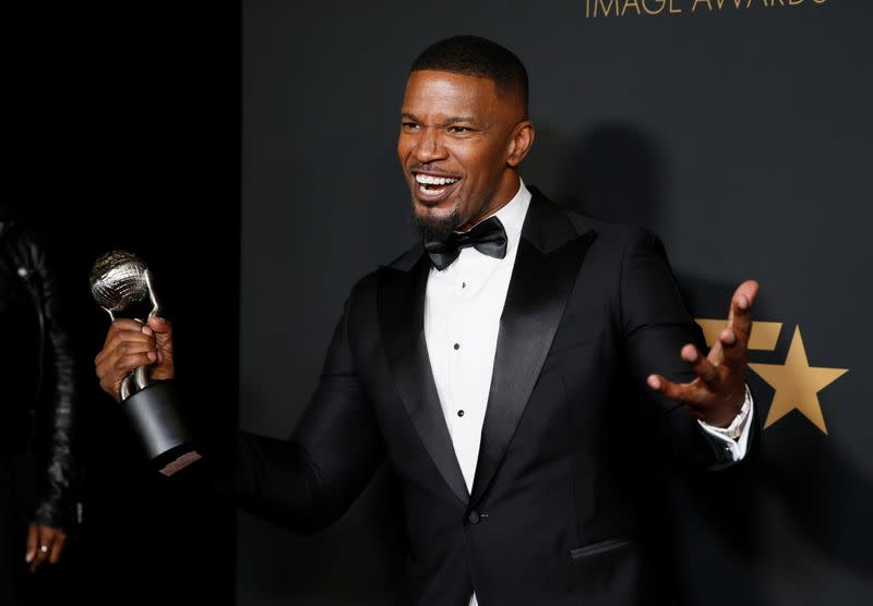 """FILE PHOTO: 51st NAACP Image Awards – Photo Room– Pasadena - Jamie Foxx poses backstage with his Outstanding Supporting Actor in a Motion Picture award for """"Just Mercy\"""