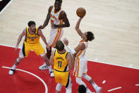 Atlanta Hawks Trae Young, right, shoots the ball against Indiana Pacers' Domantas Sabonis, left, during the first half of an NBA basketball game on Sunday, April 18, 2021, in Atlanta. (AP Photo/Brynn Anderson)