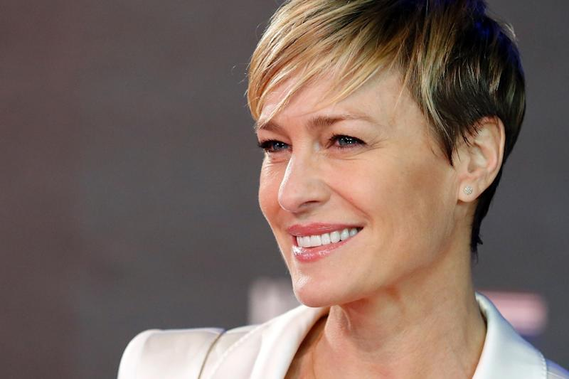 US actress Robin Wright poses for photographers on the red carpet ahead of the world premiere of the television series 'House of Cards - Season 3 Episode 1' in London on February 26, 2015