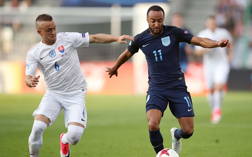 Slovakia's Stanislav Lobotka (left) and England's Nathan Redmond battle for the ball - Credit: PA