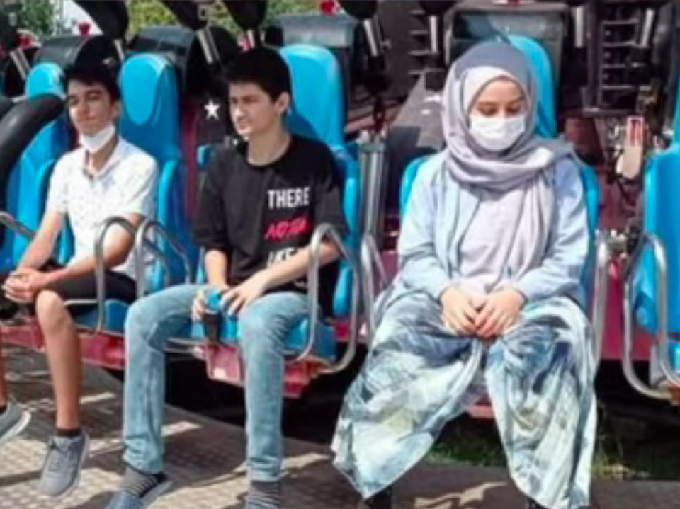 The last picture of Zeynep Gunay, 19, on the swing ride with her relatives.