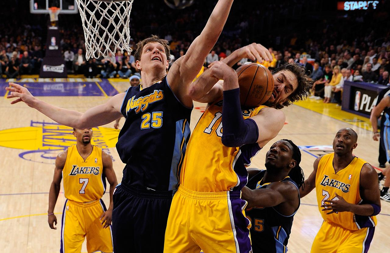 LOS ANGELES, CA - MAY 12:  Pau Gasol #16 of the Los Angeles Lakers and Timofey Mozgov #25 of the Denver Nuggets battle for a rebound in the first half in Game Seven of the Western Conference Quarterfinals in the 2012 NBA Playoffs on May 12, 2012 at Staples Center in Los Angeles, California. NOTE TO USER: User expressly acknowledges and agrees that, by downloading and or using this photograph, User is consenting to the terms and conditions of the Getty Images License Agreement.  (Photo by Kevork Djansezian/Getty Images)